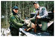 South of Crystal Falls, Iron County, November 15, 2006. COs Jason Wicklund (l) and Dave Painter (r) pose with 3 year old gray wolf illegally shot the day before. This photo was taken when we went to retrieve the animal for the evidence locker and immediately after getting a confession from the shooter.